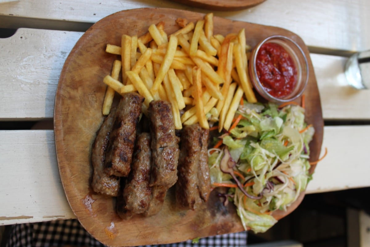 Eating Cevapi at Grillmania in Budapest