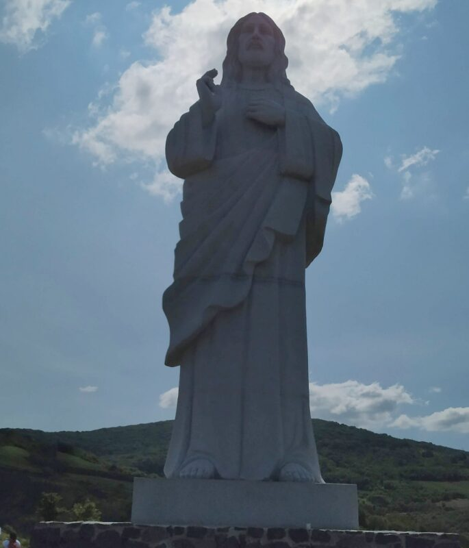 The Jesus statue in Tarcal seen standing in front of it